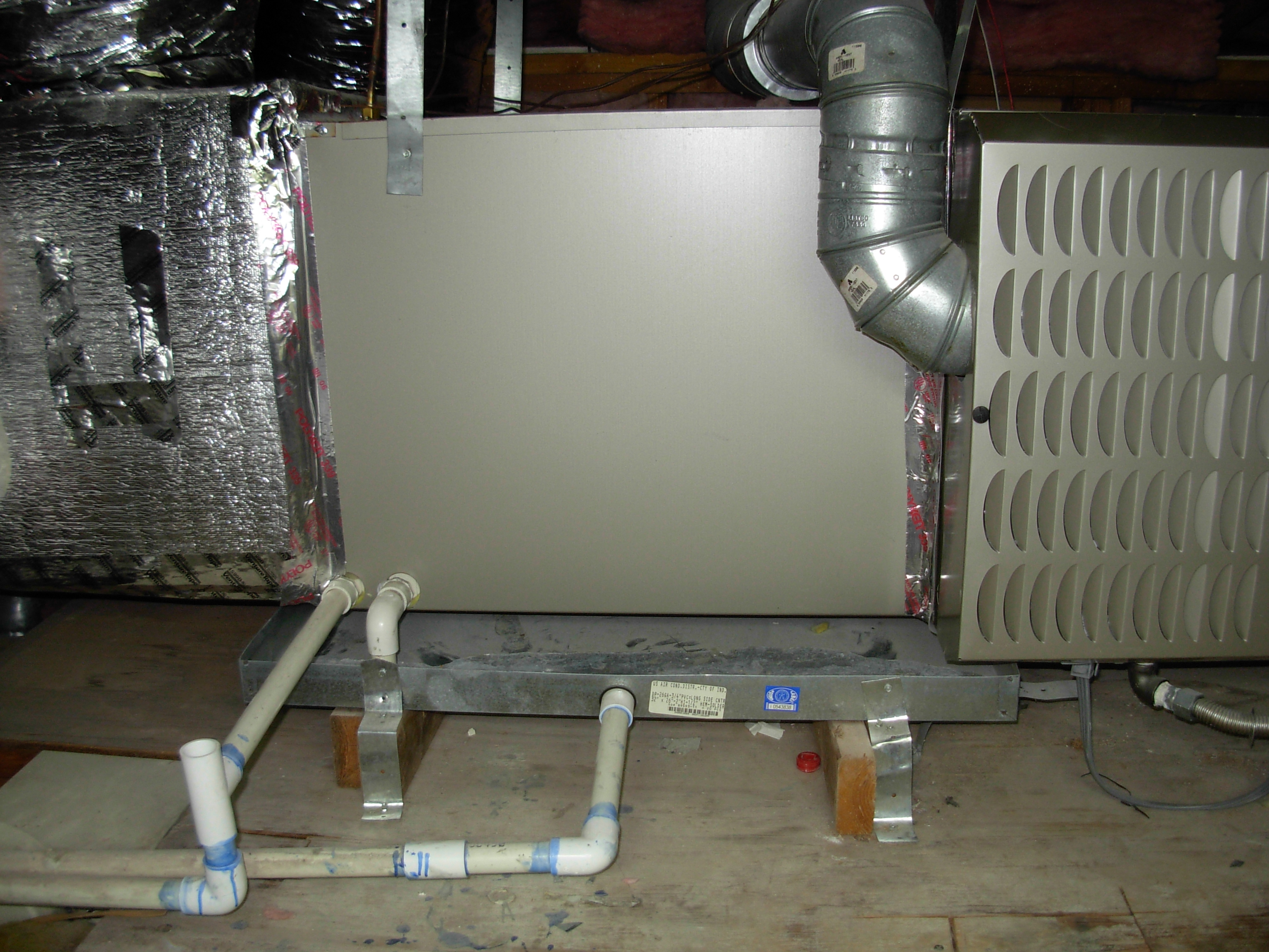 horizontal cooling coil with seconndary drain pan and drain line